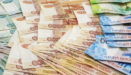paper banknotes of two hundred rubles one thousand, two and five thousand rubles of the Russian Federation on an isolated background Фото со стока