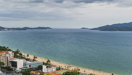from a birds eye view, view of the islands, the East Sea, a stretch of beach, buildings, and people on the beach