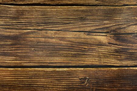 background from old wooden pine boards in dark