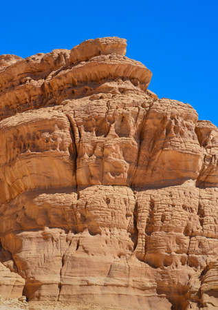 a mountain of red sandstone, not the usual form that was formed as a result of the action of winds and rains