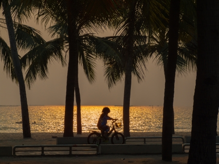 Small boy practice riding a bicycle on the beach in Bangsan, Thailand  photo