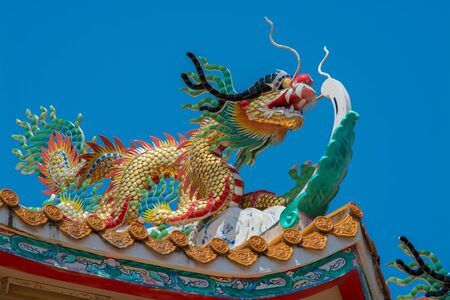 Chinese dragon decorative sculpture on rooftop in temple, Thailand  photo