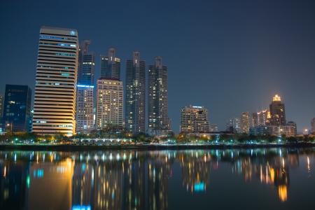 Business district skyline scene view from Benjakiti Park in Bangkok