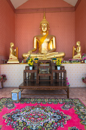 Buddha statue with a money contribute box for maintaining on the floor Stock Photo - 25012928