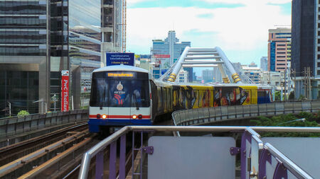 runing: Electric railway train runing through the inner Bangkok Metropolitan business district and to the outskirts including the airport.