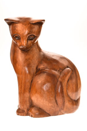 Teak wood carving cat figure. Stock Photo