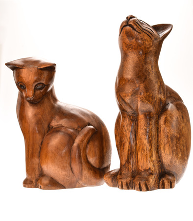 teak wood: Teak wood carving cat figure. Stock Photo