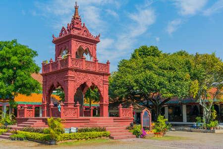 A bell tower in Wat Phrathat Hariphunchai Woramaha Vihan, Buddhist temple in Lamhun, Thailand.