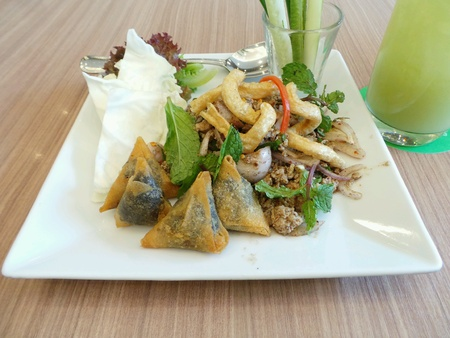 Spicy Minced Pork Salad Served with purple sticky rice.