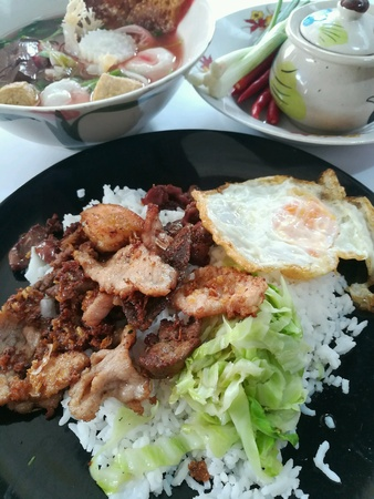 Deep fried mixed meat with cabbage and steamed rice.
