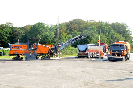 Sonderborg, Denmark - August 27, 2019: Asphalt milling machine at work in a road crossing