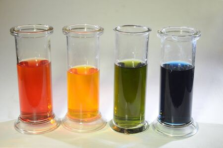 """The four most significant states of the indicator """"BTB"""" = Bromothymol blue, left red in strong acid, then yellow in mild acid, green for neutral, and blue for alkaline."""