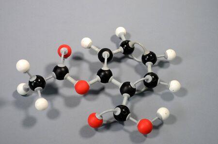 Molecule model of acetylsalicylic acid HC9H7O4 (ASA). Red is oxygen, black is carbon, and white is hydrogen. Reklamní fotografie