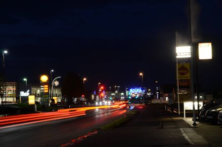 Sonderborg, Denmark - November 16, 2016: Nighttime scene with light trails from traffic, christmas lights, and illuminated signs.