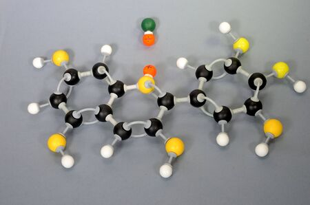 Molecule model of Paraffin. White is Hydrogen, black is Carbon, yellow is Oxygen and green is Chlorine. The orange spheres represent charges in a coordinate covalent bond.