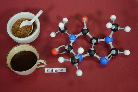 Molecule model of Caffein (Coffein). White is Hydrogen, black is Carbon, red is Oxygen and blue is Nitrogen.