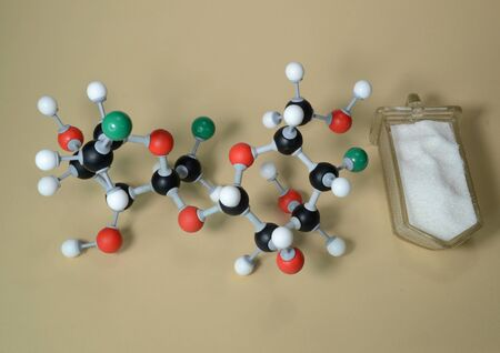 Molecule model of the sweetener Sucralose (E955). White is Hydrogen, black is Carbon, red is Oxygen, and green is chlorine.