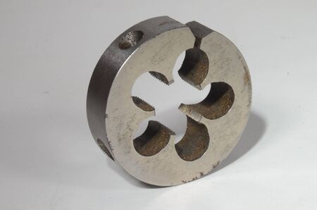 Closeup on die tool for cutting outer hreads