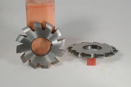 Milling tools for making teeth on gear wheels, two alike speciments, one in side view and one in profile view Stockfoto