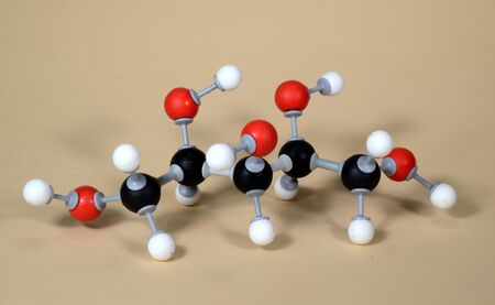 Molecule model of the sweetener Xylitol (E967). White is Hydrogen, black is Carbon, and red is Oxygen