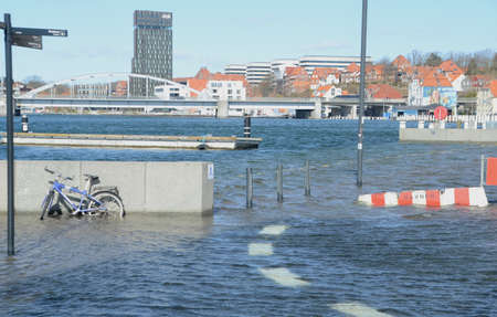 Sonderborg, Denmark - March 29, 2020: Flooded urban harbor area during an extraordinary high tide.