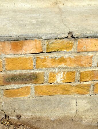 Crack in a building's base due to subsidence Stock Photo - 145853879