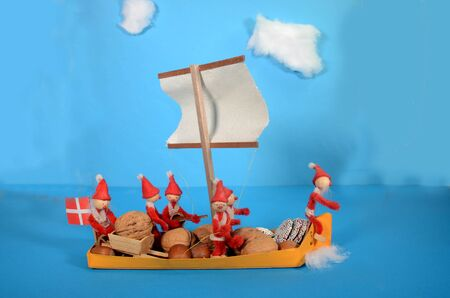 Pixie family on their way in a yellow ship Stockfoto