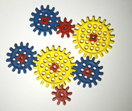Colorful gear wheels on a white background. Stockfoto