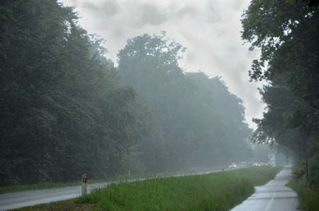 Road with bad visibility due to heavy rain. Stockfoto