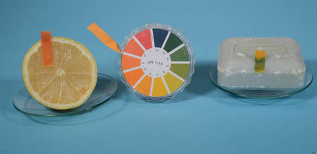 Universal indicator paper for pH value is shown in use on a lemon with a pH value of approx. 2, and a piece of hand soap with a pH value of approx. 11