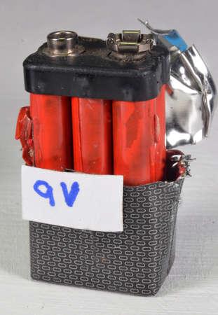 Opened 9V (type E) battery. Internally it consists of 6 pcs. 1,5 Volt cells.