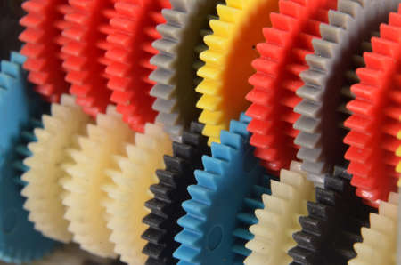 Diagonal view of a row with colorfulgear wheels Stockfoto