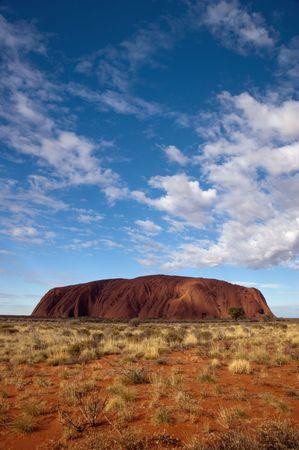 large rock: Ayers Rock - Uluru with cloudy sky