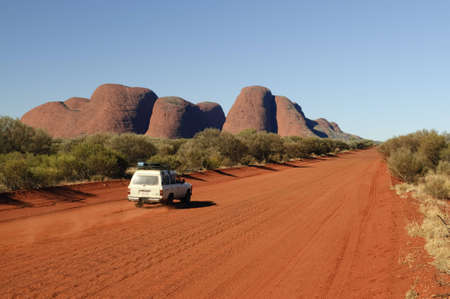 mounts: Offroader in front of Olgas on red dirt road
