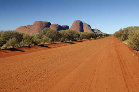 olgas: Red dirt road in front of Olgas Stock Photo