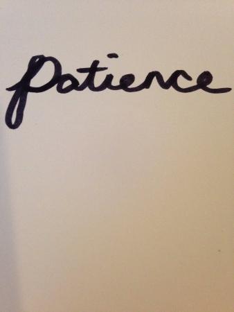 paciencia: La paciencia en el fondo blanco Foto de archivo