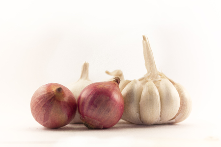 pungent: Garlic and onion isolated on white background