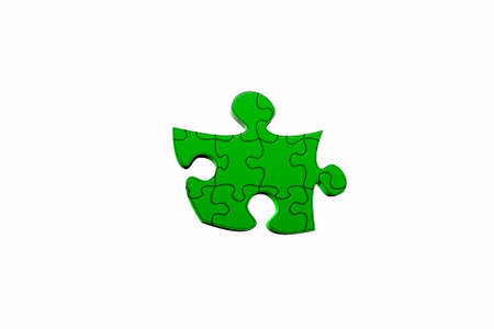 Isolated green puzzle. Stock Photo