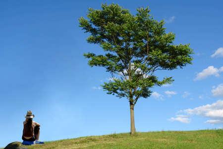 Single woman and tree