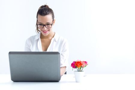 Beautiful young woman with laptop working at home
