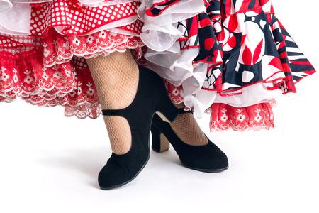 flamenco dancer: Detalle Pies de bailarina de flamenco en un hermoso vestido en el fondo blanco Foto de archivo