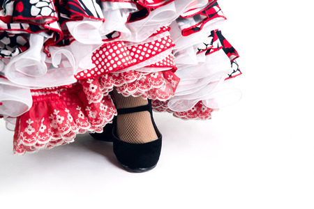 spanish dancer: Feet detail of Flamenco dancer in beautiful dress on white background