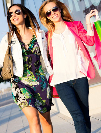 friends: two happy young friends shopping together in town Stock Photo