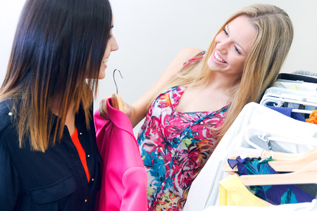 woman clothes: Portrait of ntwo young friends looking for clothes in the store Stock Photo