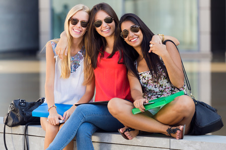 group of friends: Portrait of pretty student girls having fun at the campus