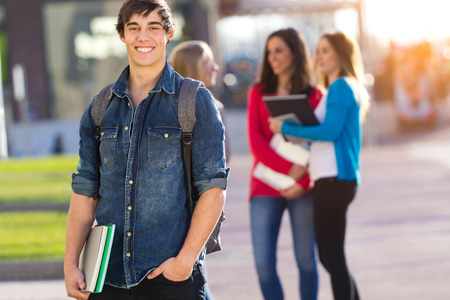 young man: Young student boy looking at the camera after class Stock Photo