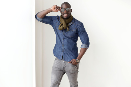 black beauty: Fashion portrait of handsome young man posing at home.