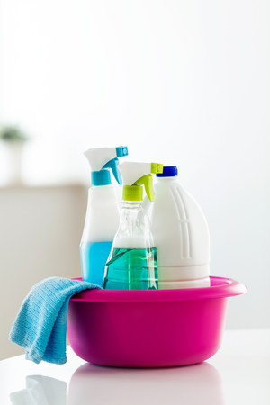 Close-up of cleaning set for different surfaces in kitchen, bathroom and other rooms at home. Stock Photo