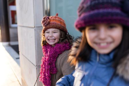 Portrait of two llittle sisters having fun in the street. 스톡 콘텐츠