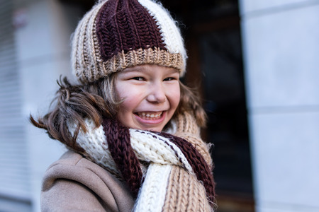 Portrait of happy young girl posing in the street. Stock Photo
